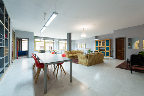 a living room filled with furniture next to a building