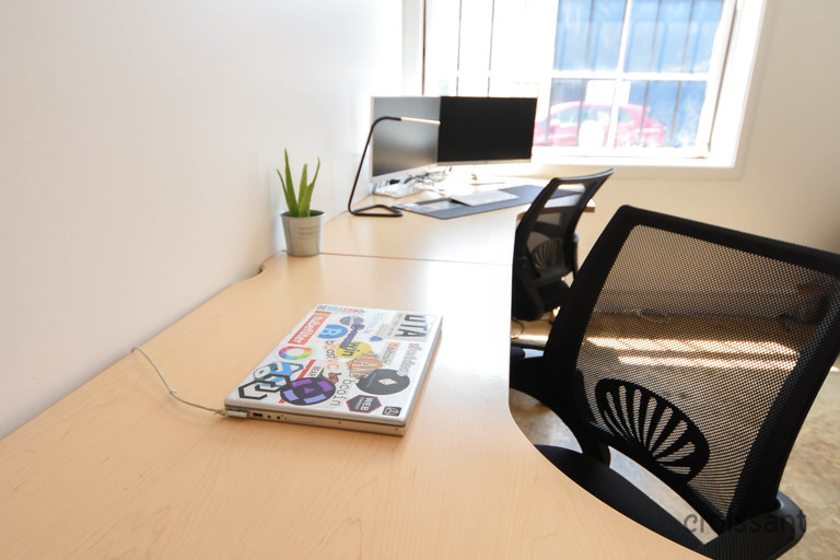 a desk with a computer on a table