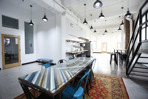 Enjoy working from bright lights and high ceilings common work area