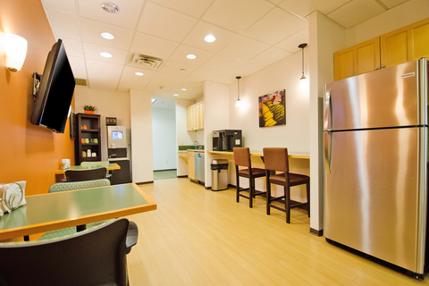 a kitchen with a stainless steel refrigerator in a room