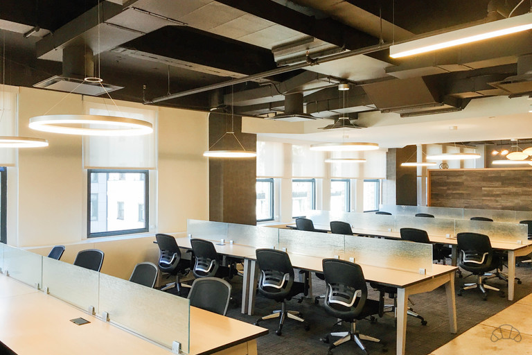 Multiple rows of coworking desk which provides a productive way to work