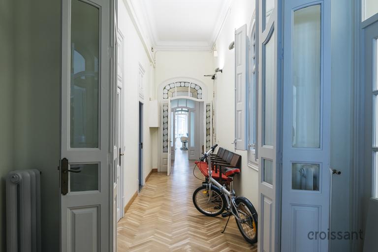a bicycle next to a door