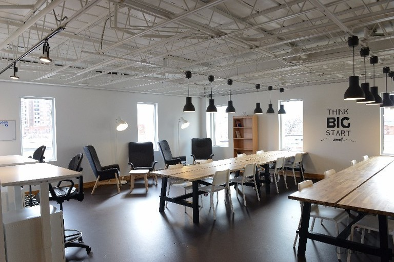 a room filled with furniture and a table