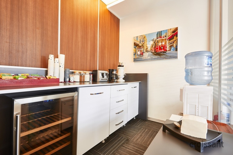 a kitchen with a refrigerator and a table