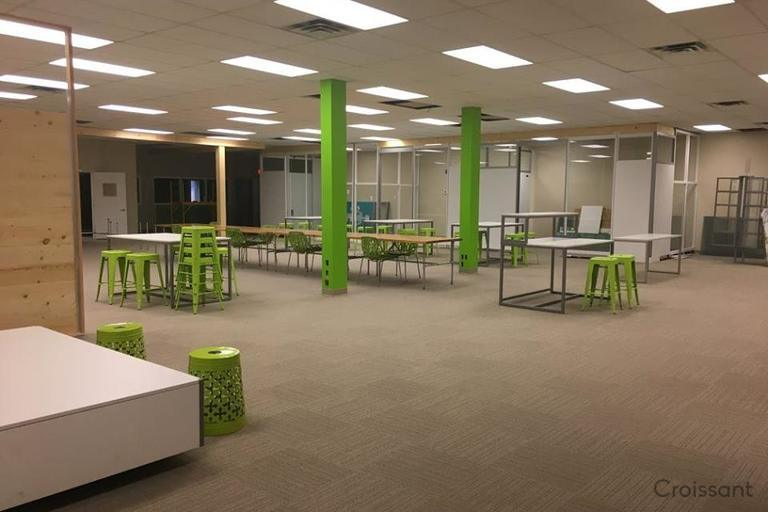 main coworking space with stacked chairs