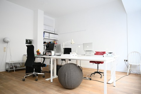 a room with a desk and chair