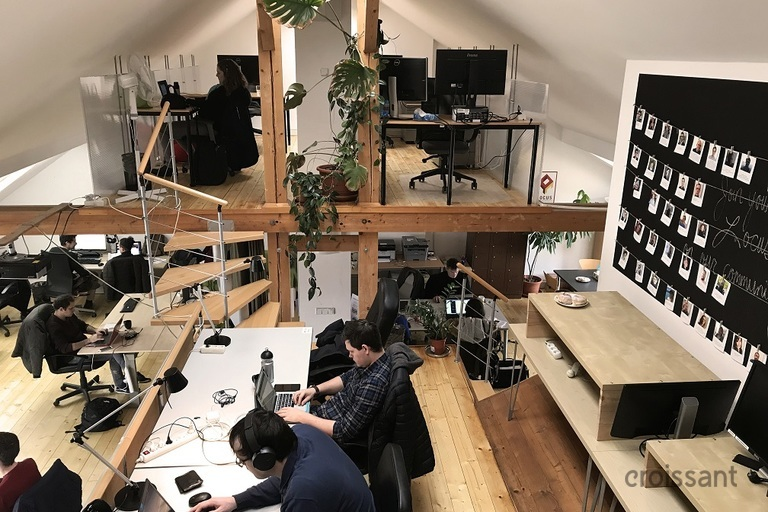 a person sitting at a desk in a room