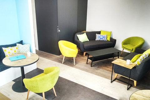 a yellow chair in a room