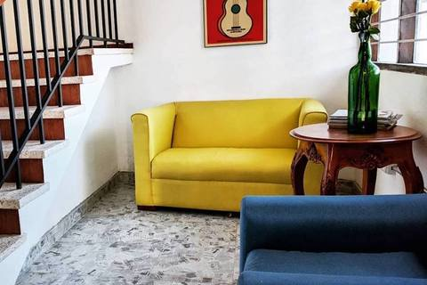 a yellow chair in a living room