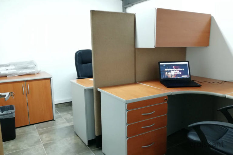 a desk with a computer in an office
