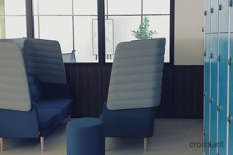 a blue chair in a room
