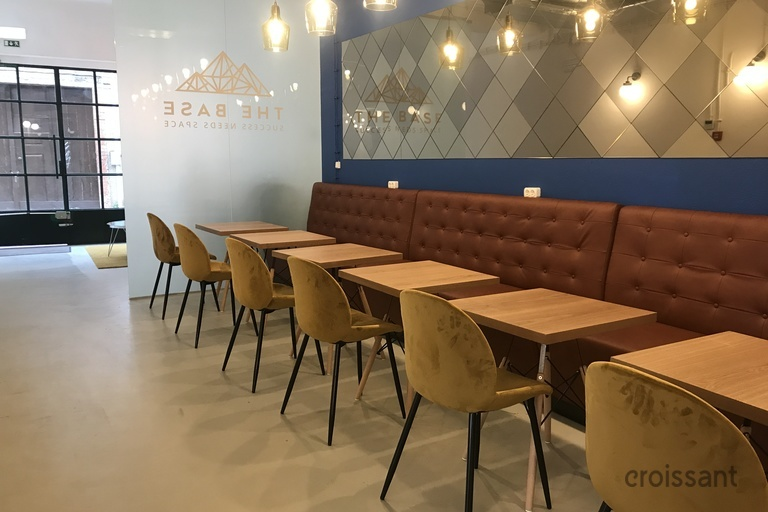a room with tables and chairs