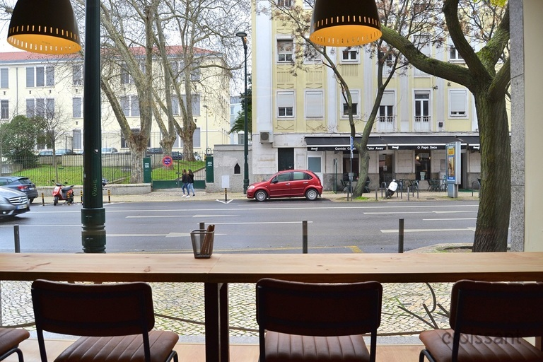 a bench on a city street