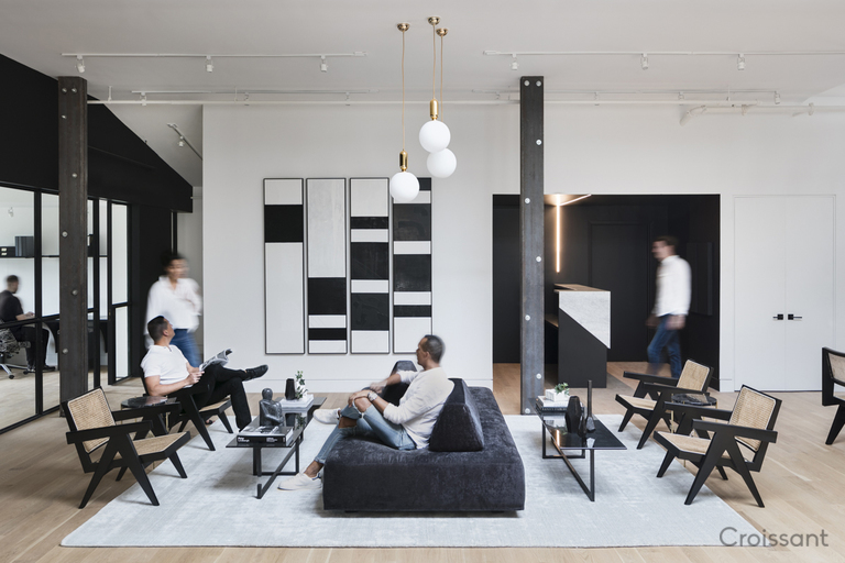 a group of people in a living room filled with furniture and a fireplace