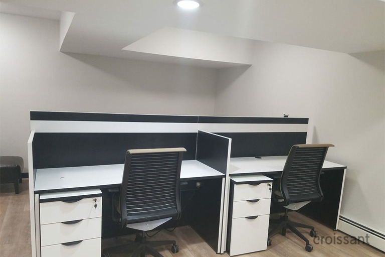 an office with a desk and chair in a room